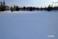 残雪に覆われた神仙沼