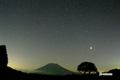 サクランボの木と羊蹄山~皆既中の月と星空